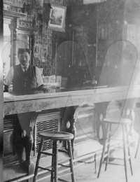 Mike Schmidbauer and a bar he owned. 1910 census listed name as Schmidbauer, occupation saloon keeper
